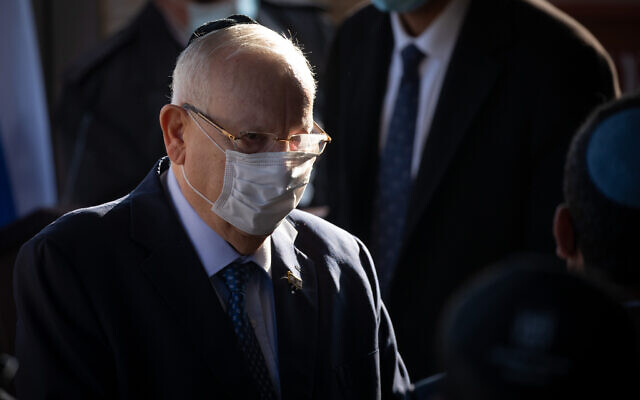 Illustrative: President Reuven Rivlin, attends a funeral at Givat Shaul cemetery in Jerusalem, on December 31, 2020. (Yonatan Sindel/Flash90)