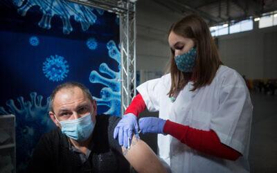 A Clalit Health Service-run vaccination center in Petah Tikva, January 27, 2021. (Miriam Alster/Flash90)