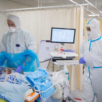 Shaare Zedek hospital team members wearing safety gear as they work in the coronavirus ward on January 27 (Olivier Fitoussi/Flash90)