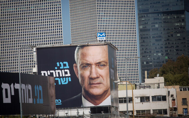An election poster showing Blue and White party Benny Gantz, posted alongside the Ayalon highway in Tel Aviv, February 1, 2021. (Miriam Alster/FLASH90)