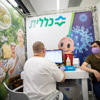 An Israeli receives a vaccine injection at a Clalit COVID-19 vaccination center in Holon on February 4, 2021. (Chen Leopold/Flash90)