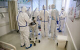 Illustrative: Medical staff in the coronavirus ward of Ziv Medical Center in the northern Israeli city of Safed, on February 4, 2021. (David Cohen/Flash90)