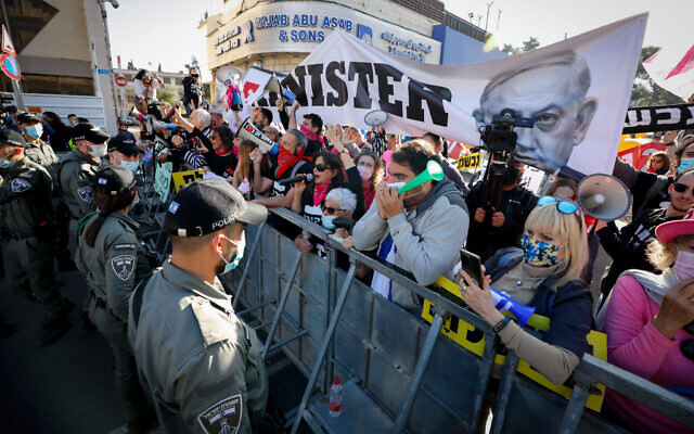 Anti-Netanyahu protesters outside the District Court in Jerusalem, as Prime Minister Benjamin Netanyahu arrives for his trial at the District Court, February 08, 2021 (Olivier Fitoussi/Flash90)