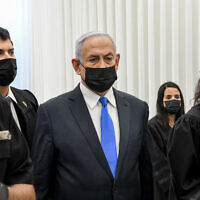 Prime Minister Benjamin Netanyahu arrives for a court hearing at the District Court in Jerusalem on February 8, 2021. Netanyahu is charged with fraud and breach of trust in three cases and bribery in one of them. (Reuven Kastro/POOL)