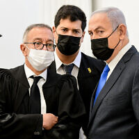 Prime Minister Benjamin Netanyahu arrives a hearing in his corruption case at the Jerusalem District Court, February 8, 2021. (Reuven Kastro/Pool)