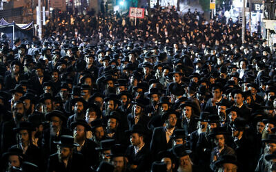 Ultra-Orthodox Jewish men attend a rally against the coronavirus restrictions and enforcement, in Jerusalem's Mea Shearim neighborhood, February 9, 2021. (Noam Revkin Fenton/Flash90)