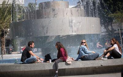 Israelis sit in Dizengoff Square in Tel Aviv on February 15, 2021. (Miriam Alster/Flash90)