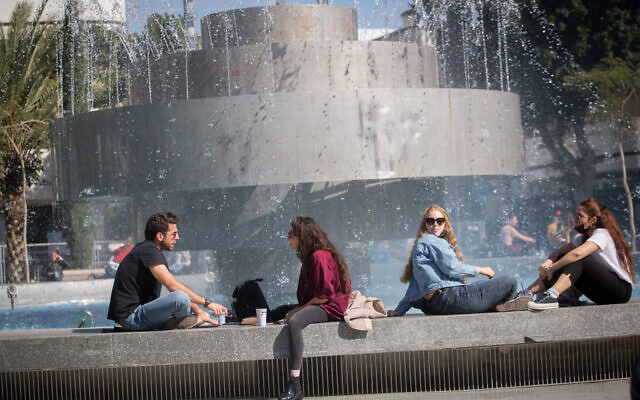 Israelis sit in Dizengoff Square in Tel Aviv on February 15, 2021. (Miriam Alster/Flash90)