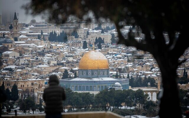 View of the snow covered Dome ot the Rock in Jerusalem's Old CIty, as seen from the Mount of Olives, on February 18, 2021. (Yonatan Sindel/Flash90)