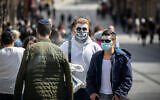 People wearing costumes in Jerusalem on February 24, 2021. (Olivier Fitoussi/Flash90)