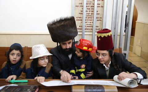Ultra-Orthodox Jews read Megillat Esther during the Jewish holiday of Purim, in the northern town of Meron on February 25, 2021. (David Cohen/Flash90)
