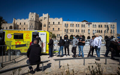 East Jerusalemites receive COVID-19 vaccine injections at the Damascus Gate in Jerusalem Old City on February 26, 2021. (Olivier Fitoussi/Flash90)