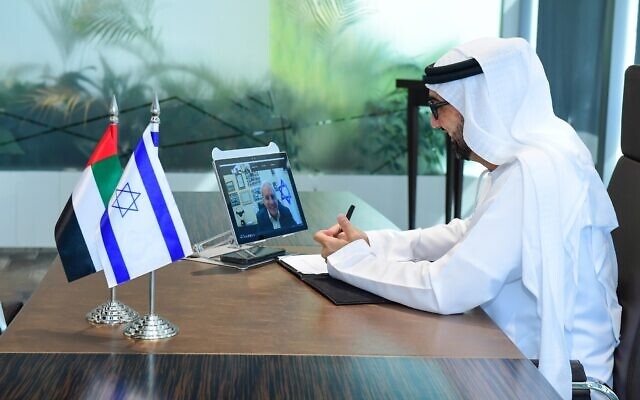 Tariq Bin Hendi, director general of the Abu Dhabi Investment Office, signs a cooperation agreement virtually with David Leffler, director general of the Ministry of Economy and Industry of Israel (on screen). (Courtesy)