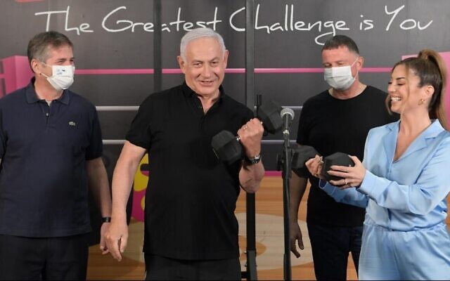 Prime Minister Benjamin Netanyahu visits a gym on Saturday, February 20, to urge vaccinated Israelis to use a 'Green Pass' to access sports and culture as Israel begins reopening (PMO/Amos Ben Gershon)