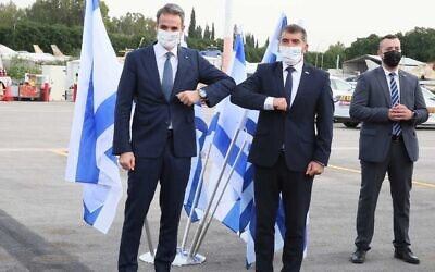 Greek Prime Minister Kyriakos Mitsotakis meets with Foreign Minister Gabi Ashkenazi in Israel on February 8, 2021. (Miri Shimonovitz/Courtesy)