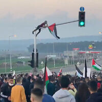Thousands protest on Saturday, February 6, 2021 in the Arab-Israeli town of Tamra, northeast of Haifa, where a nursing student was killed earlier in the week in a shootout between police and suspected criminals. (Screenshot: Twitter)