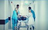 Illustrative image of medics treating a patient (YouTube screenshot)