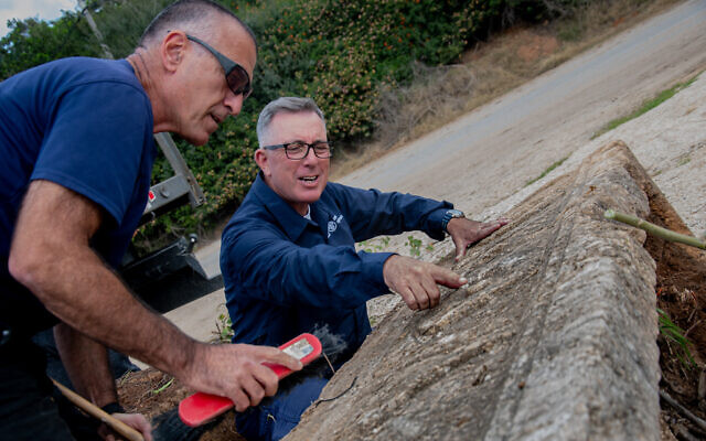 Cleaning an 1,800-year-old sarcophagus discovered at the Ramat Gan Safari Park (Israel Antiquities Authority)