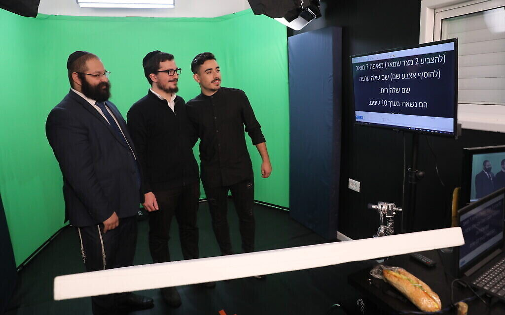Rabbi Yehoshua Soudakoff (left) in the green screen room with actors Daniel Malka (center) and Chen Belilty. (Courtesy)