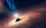 Illustration of a black hole with an accretion disk around it. As a result of the accretion of material from a destroyed star, powerful jets are launched. (Elen11 via iStock by Getty Images)
