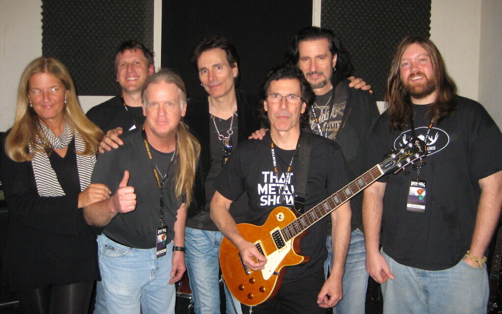 Bruce Kulick, back row second from right, with fellow rock star counselors including guitar legend Steve Vai, back row center, at a Rock N' Roll Fantasy Camp. (Courtesy of Kulick)