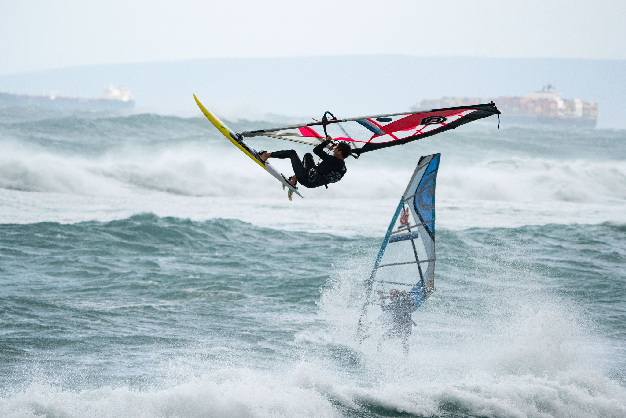 A windsurfer catches air at the extreme Storm Riders competition in Haifa, Wednesday, February 17, 2021. (Photo by Uri Magnus/ www.urimagnus.com)