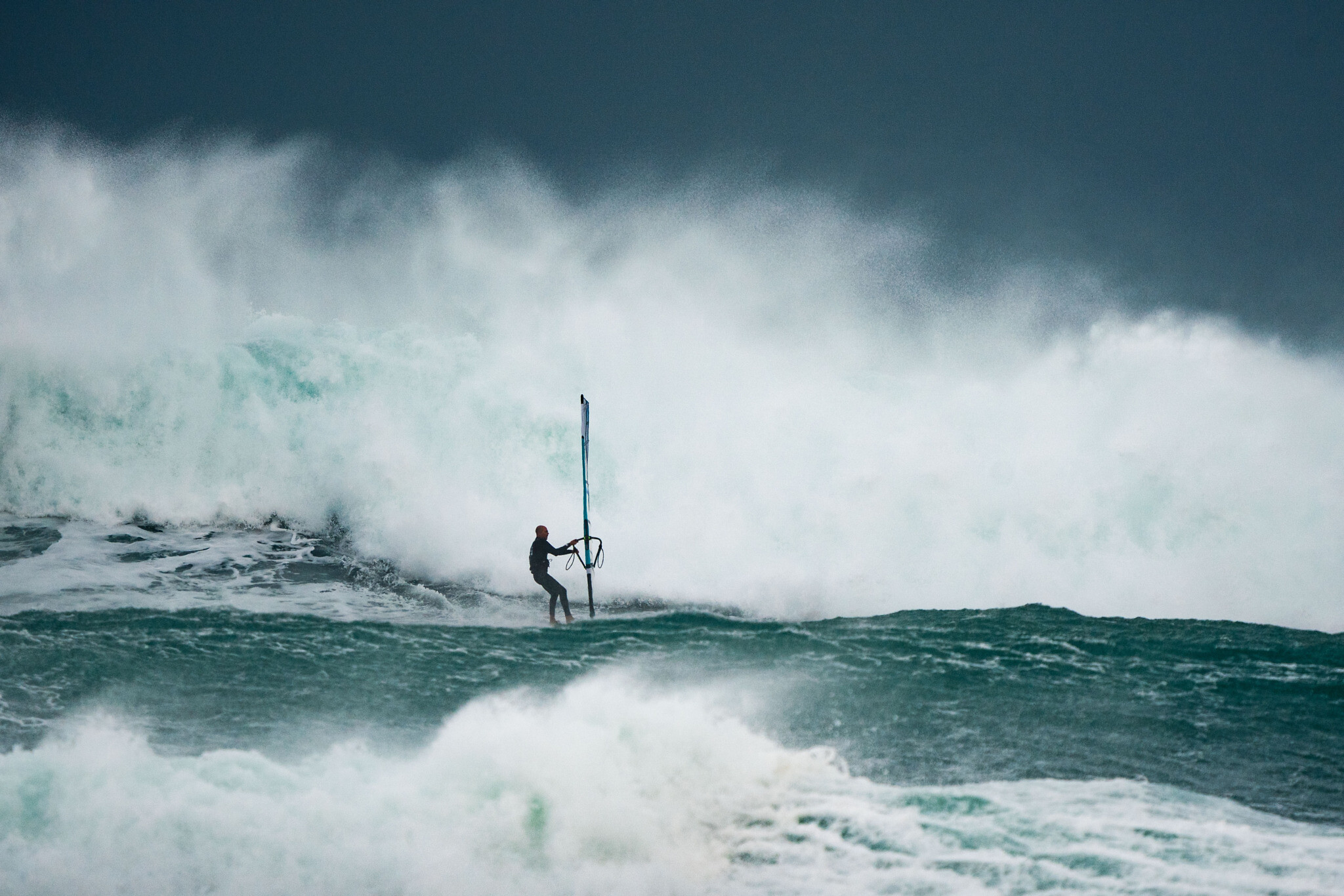 Windsurfer Ori Dagan battles enormous waves at the extreme Storm Riders competition in Haifa, Wednesday, February 17, 2021. (Photo by Uri Magnus/ www.urimagnus.com)