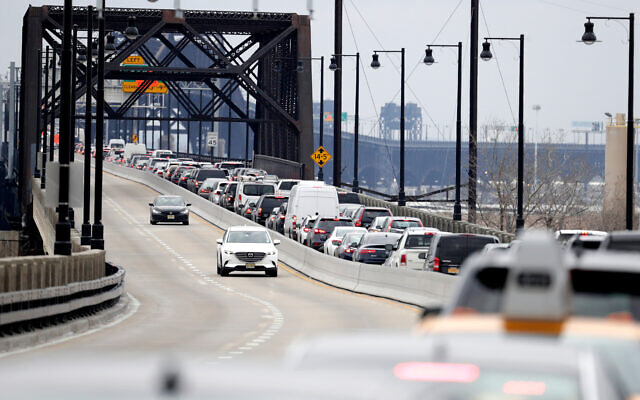 Illustrative: Speeding cars and a traffic jam in Jersey City, New Jersey, January 16, 2019. (AP Photo/Julio Cortez)