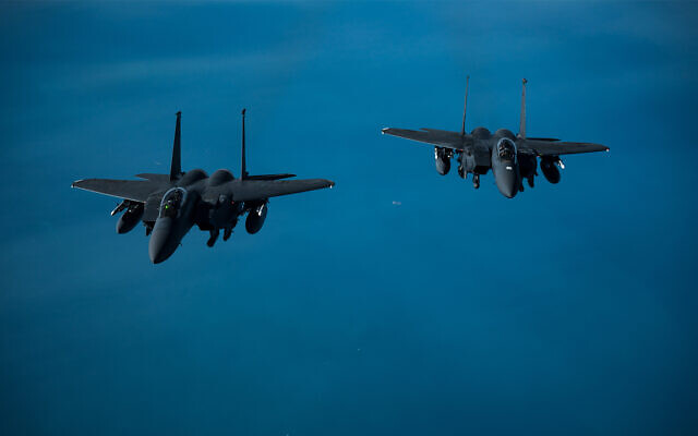 Two US Air Force F-15 Strike Eagles fly over the US Central Command area of responsibility in an undisclosed location, Feb. 10, 2021. (US Air Force/Staff Sgt. Sean Carnes)