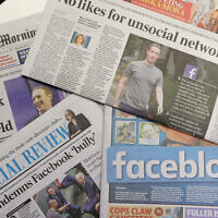 Front pages of Australian newspapers are displayed featuring stories about Facebook in Sydney, Feb. 19, 2021. (AP Photo/Rick Rycroft)