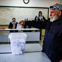 A Palestinian man casts a ballot during elections for the Fatah movment in the Nablus area, on the outskirts of the West Bank city of Nablus, January 23, 2021. (Nasser Ishtayeh/Flash90)