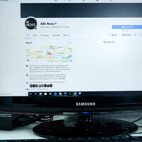 An Australian Broadcasting Corporation page on Facebook is displayed without posts in Sydney, Feb. 18, 2021. (AP Photo/Rick Rycroft)