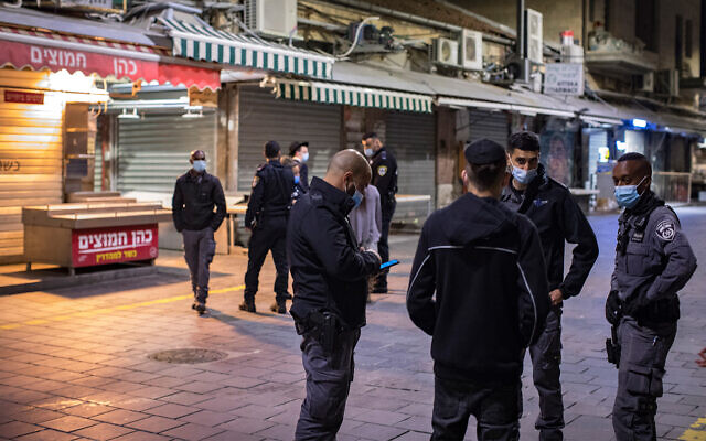 Police patrol the Mahane Yehuda market, as they enforce a night curfew during Purim, Jerusalem February 27, 2021. (Olivier Fitoussi/Flash90)