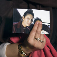 Renu, eldest sister of missing British woman Shamima Begum, holds a picture of her sister while being interviewed by the media in central London, February 22, 2015. (Laura Lean/Pool/AFP)