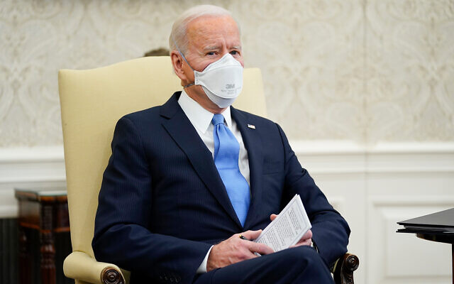 US President Joe Biden speaks during a meeting with a bipartisan group of mayors and governors to discuss a coronavirus relief package, in the Oval Office of the White House, Feb. 12, 2021, in Washington. (AP Photo/Evan Vucci)