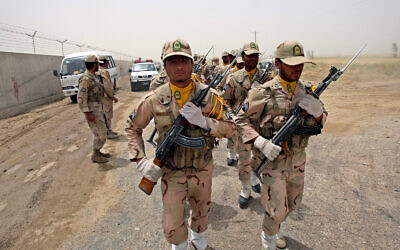 lllustrative: A group of Iranian border guards march at the eastern border of Iran shared with Pakistan and Afghanistan near Zabol, Sistan and Baluchestan Province, Iran, July 19, 2011. (AP Photo/Vahid Salemi, File)