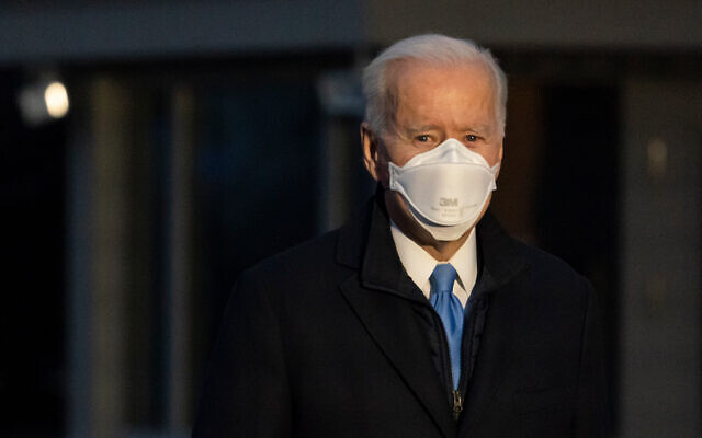 US President Joe Biden speaks with reporters as he walks to Marine One for departure from the South Lawn of the White House in Washington, Feb. 12, 2021. (AP Photo/Alex Brandon)