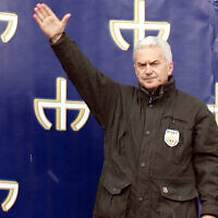 Far-right politician Volen Siderov lifts his arm at a political rally in Sofia, Bulgaria on March 11, 2011. (Wikimedia Commons via JTA)