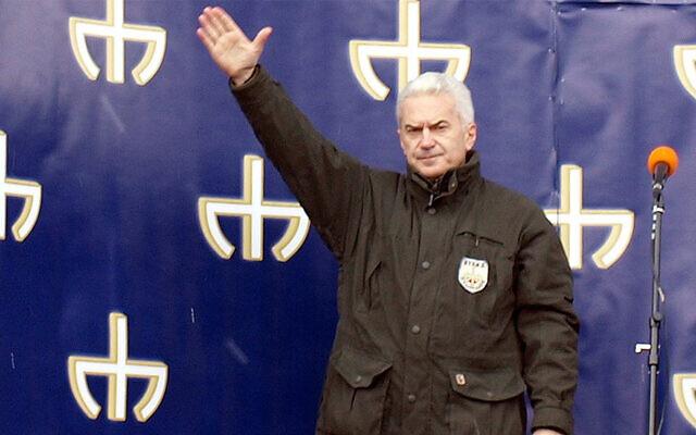Far-right politician Volen Siderov lifts his arm at a political rally in Sofia, Bulgaria on March 11, 2011. (Wikimedia Commons via JTA)