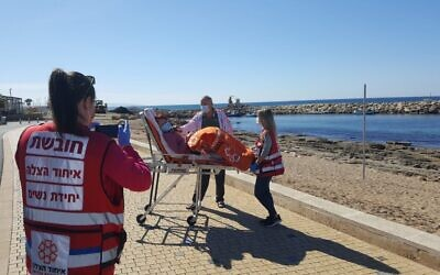 United Hatzalah medics in Nahariya take a Holocaust survivor to the beach, after a trip to a vaccination center. (Courtesy of United Hatzalah)