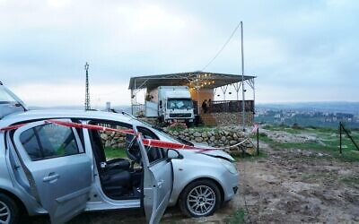 A Palestinian man's car outside the home of an Israeli man on the illegal Sadeh Efraim Farm outpost in the northern West Bank, where the Israeli military says the man attacked someone before being shot dead on February 5, 2021. (Israel Defense Forces)
