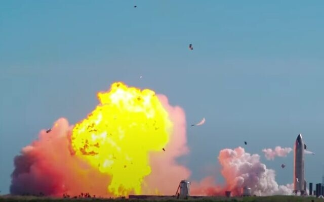 A SpaceX Starship prototype explodes in a fireball as it tries to land upright after a test flight (YouTube screenshot)