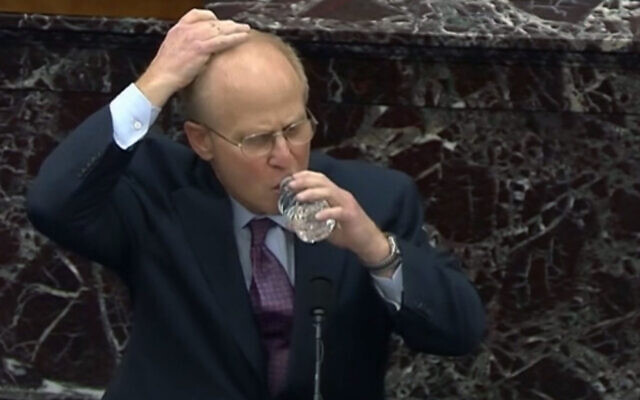 Former US president Donald Trump's impeachment lawyer David Schoen covering his hand with his head before drinking water during a Senate hearing in Washington, DC, February 9, 2021. (Screen Capture from CNN live broadcast via JTA)