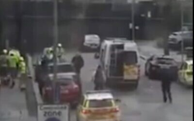Screen capture from video of an incident in which a man appeared to through a Molotov cocktail near a London synagogue, February 2, 2021. (YouTube)