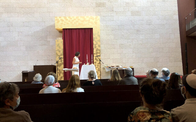A member of the GIL Jewish community, Karin Rivollet, speaks about Judaism at the GIL synagogue in Geneva, Switzerland, Sept. 6, 2020. (Courtesy of GIL via JTA)