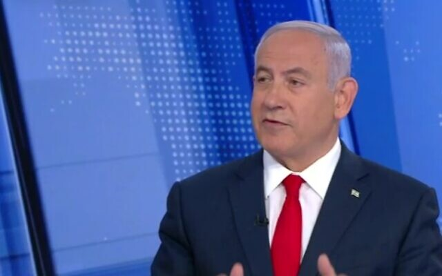 Prime Minister Benjamin Netanyahu speaks to Channel 12 News, February 15, 2021. (Screen capture/ Channel 12)