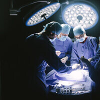 Illustrative image of a medical team performing surgery in an operating room. (jacoblund; iStock by Getty Images)