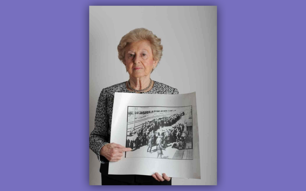 Irene Fogel Weiss points to a photo of herself upon arrival in Auschwitz in May 1944. (Lesley Weiss/ via JTA)