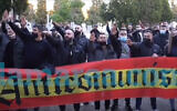 Neo-Nazis giving the Hitler salute at an event near a cemetery in Madrid, Spain on Feb. 13, 2021 (Lamarea.com via JTA)