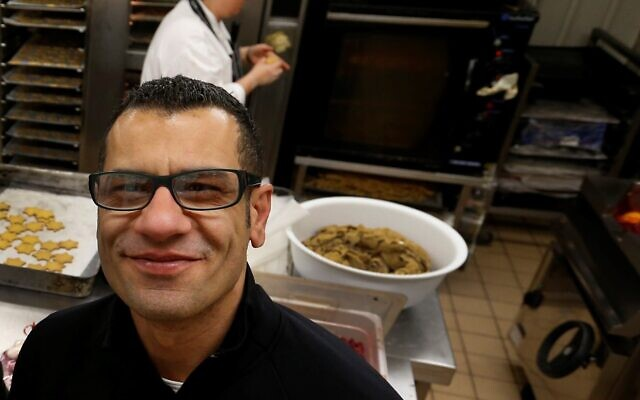 Sami Tamimi in a London bakery he co-owns with Yotam Ottolenghi on December 18, 2012. (AP/Lefteris Pitarakis)